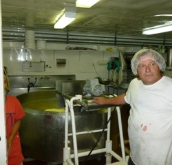 The guy who makes and cuts the cheese
